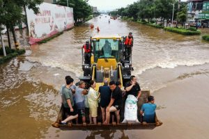 China Sends Supplies to Devastated Areas After Flooding Kills at Least 63